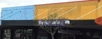 Yellow facade has the words Kings Building in ra...