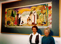Carol Bates and Zelda Paul in front of Embroidery.