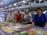Rotorua Embroiderer's Guild, cleaning Library Embroidery.